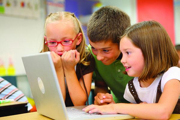 child using laptop